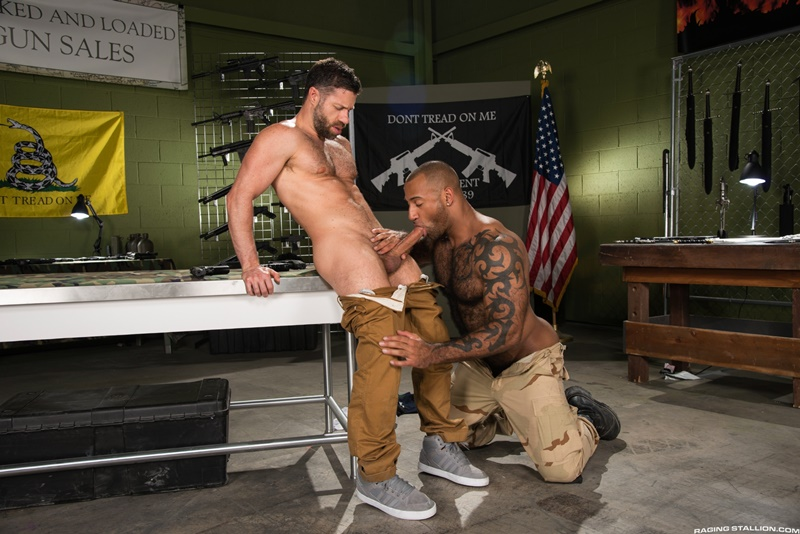 Tristan Jaxx pulls his cock out of Daymin Voss' tight hole to blast his own load of cream